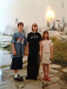 KT, middle, age 15. Because apparently black baggy clothes in mid-summer was necessary for some reason.